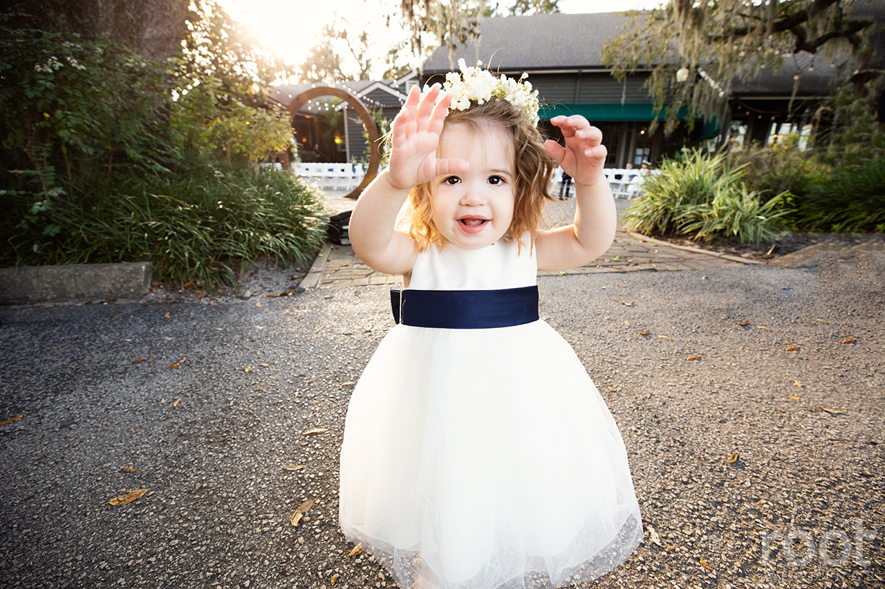 A flower girl with baby's breath floral crown