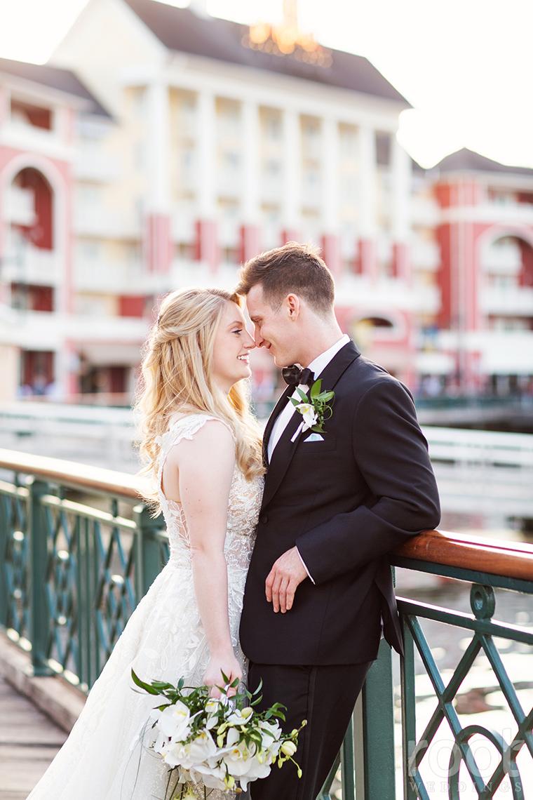 Sunset wedding photos at Disney's Boardwalk Inn Resort.