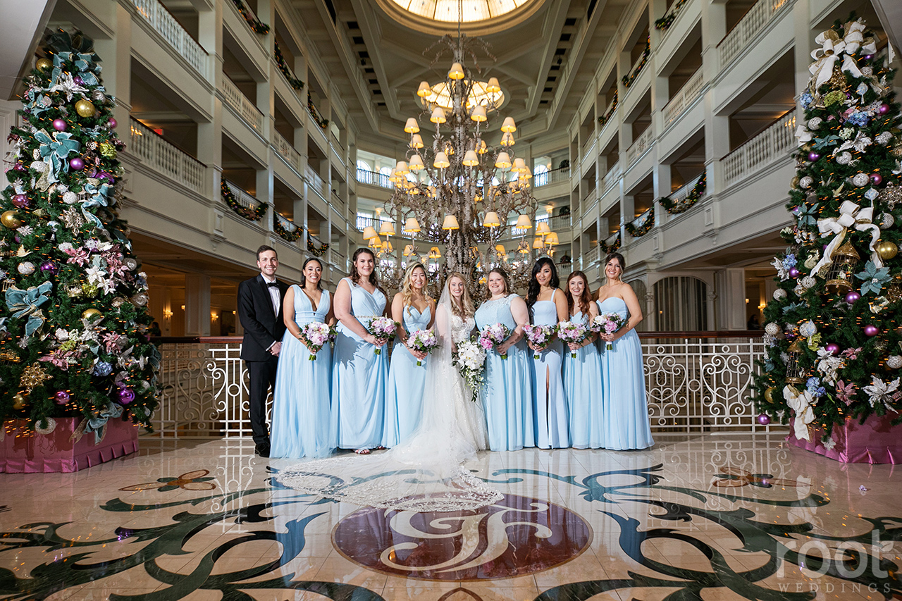 Long light blue bridesmaid dresses at the Grand Floridian chandelier