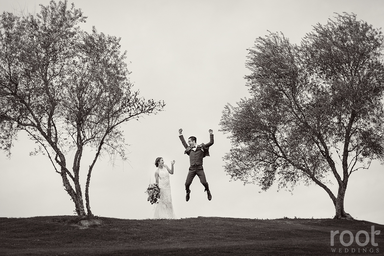 Groom jumping with joy at a Bella Collina Wedding