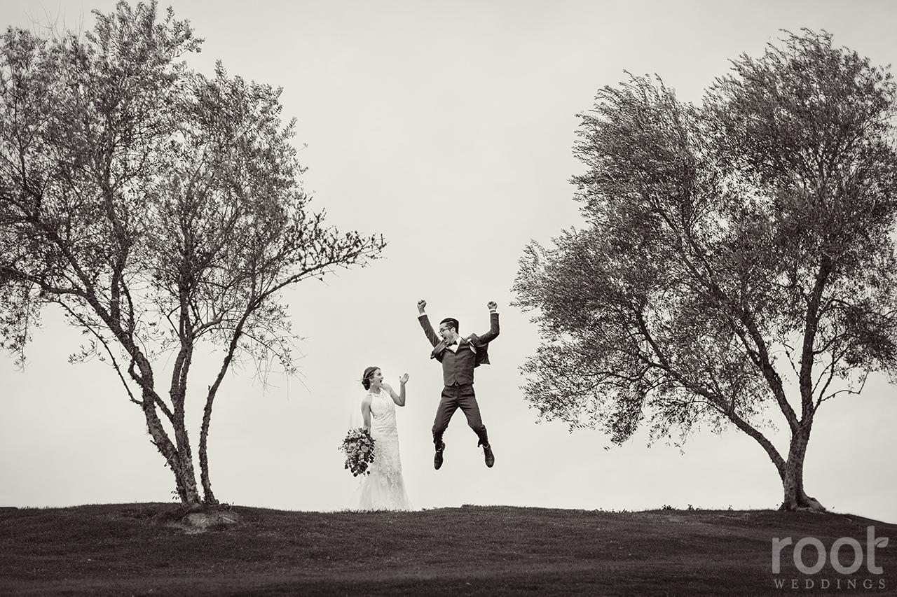 Groom jumping with joy at a Bella Collina Wedding