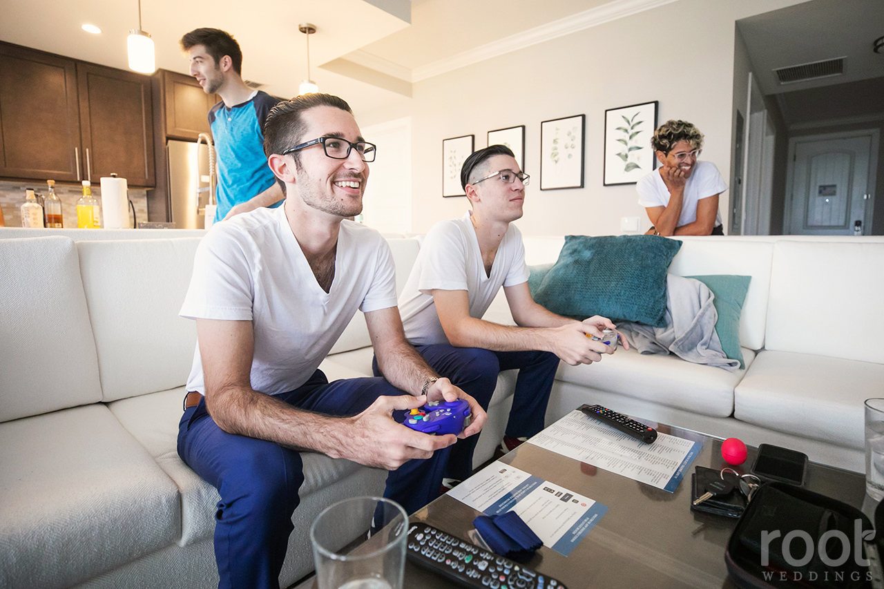 Groom playing video games before his wedding