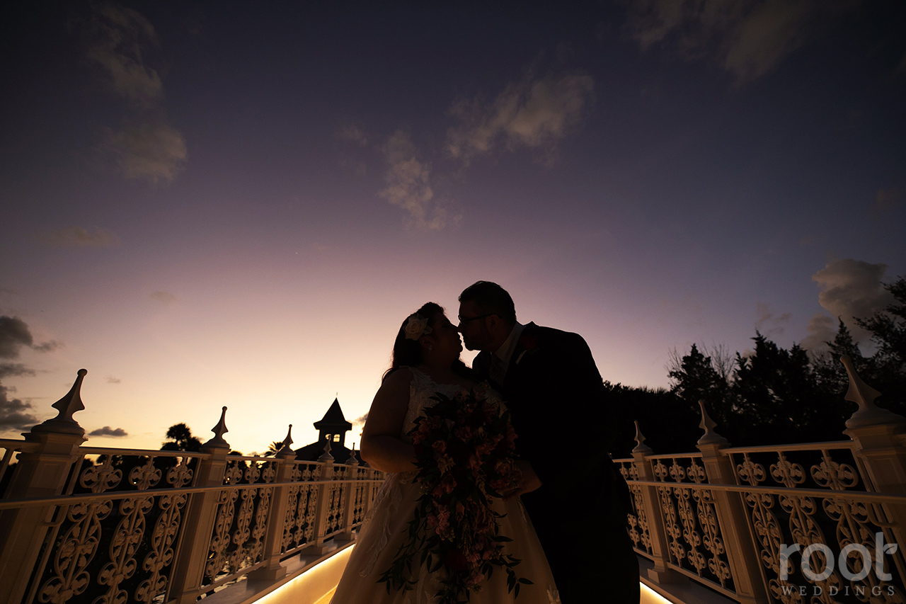 Bride and groom at sunset at Disney's Wedding Pavilion