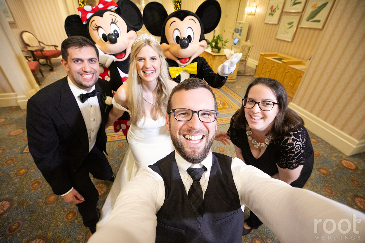 Jensey and Nate of Root Photography with Mickey and Minnie