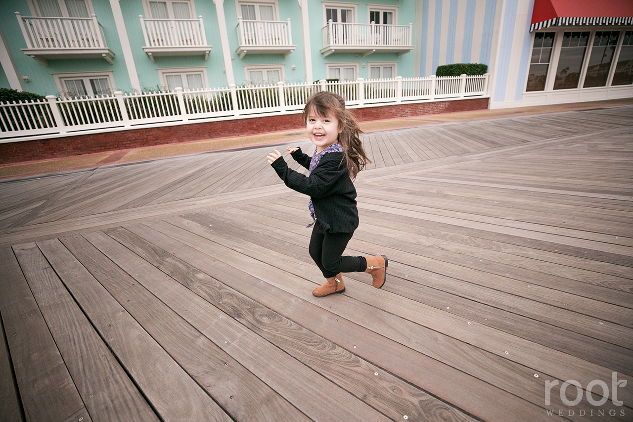 Girl running at Disney's Boardwalk during family photos