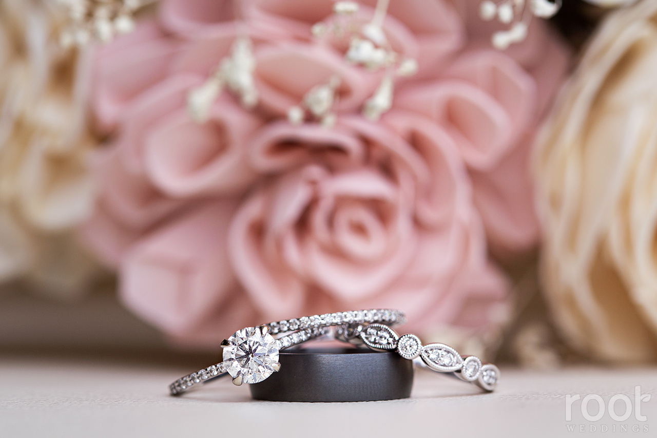 Wedding rings in front of a wood bride bouquet