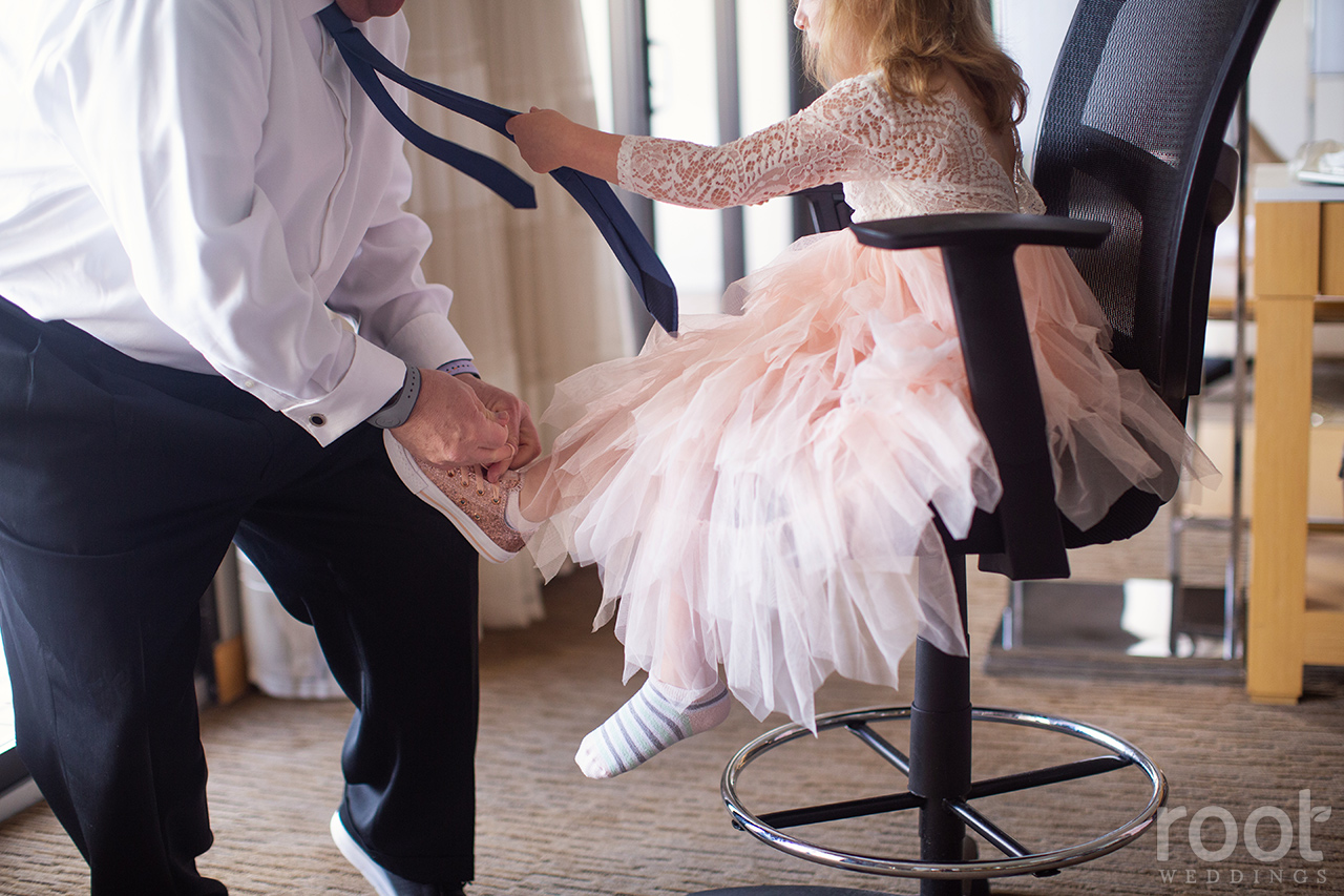 Father getting his flower girl ready
