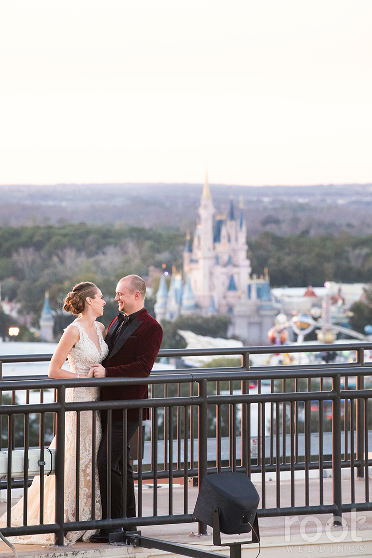 Bride and groom with Cinderella Castle